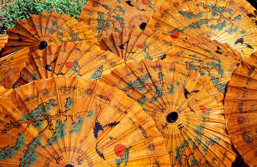Thailand.  Lacquered paper parasols, Chiang Mai.