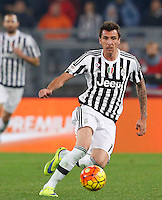 Calcio, Serie A: Lazio vs Juventus. Roma, stadio Olimpico, 4 dicembre 2015.<br /> Juventus' Mario Mandzukic in action during the Italian Serie A football match between Lazio and Juventus at Rome's Olympic stadium, 4 December 2015.<br /> UPDATE IMAGES PRESS/Riccardo De Luca