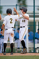 Pittsburgh Pirates Jerrick Suiter (48) high fives Hunter Owen (2) during an Instructional League game against the Tampa Bay Rays on October 3, 2017 at Pirate City in Bradenton, Florida.  (Mike Janes/Four Seam Images)