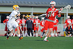Baltimore, MD - March 3:  Midfielder Neill Lewnes #4 of the UMBC Retrievers  checks Midfielder Colin McLinden #4 of the Fairfield Stags during the Fairfield v UMBC mens lacrosse game at UMBC Stadium on March 3, 2012 in Baltimore, MD.