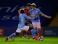 Lincoln City's Tom Hopper gets between Claudio Gomes, left, and Sammy Robinson<br /> <br /> Photographer Andrew Vaughan/CameraSport<br /> <br /> EFL Papa John's Trophy - Northern Section - Group E - Lincoln City v Manchester City U21 - Tuesday 17th November 2020 - LNER Stadium - Lincoln<br />  <br /> World Copyright © 2020 CameraSport. All rights reserved. 43 Linden Ave. Countesthorpe. Leicester. England. LE8 5PG - Tel: +44 (0) 116 277 4147 - admin@camerasport.com - www.camerasport.com