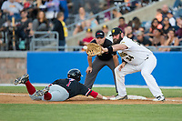 Max Casper (1) of the New Jersey Jackals dives back into forst base as Chase McDonald (34) of the Sussex County Miners waits for a pick off throw at Skylands Stadium on July 29, 2017 in Augusta, New Jersey.  The Miners defeated the Jackals 7-0.  (Brian Westerholt/Four Seam Images)