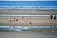 Summer Recreational Activities at White Rock, BC, British Columbia, Canada - Family sunbathing and playing on Sandy Beach along Semiahmoo Bay