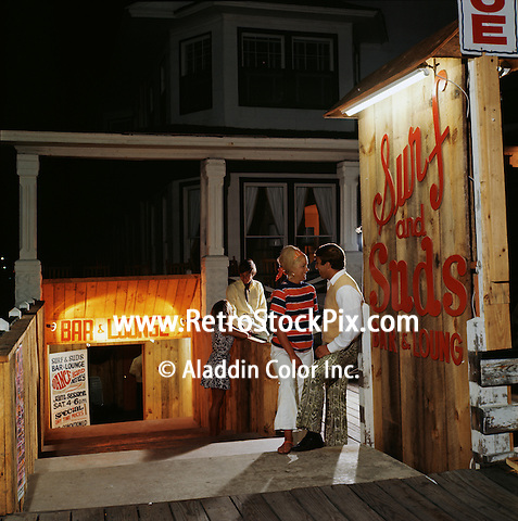 Shoreham Hotel in Ocean City, Maryland. 1969. Couples standing outside lounge.