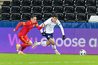 SWANSEA, WALES - NOVEMBER 12: Giovanni Reyna #7 of the United States runs with the ball during a game between Wales and USMNT at Liberty Stadium on November 12, 2020 in Swansea, Wales.