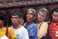 Antigua, Guatemala.  People Carrying an Anda (Float) in Easter Sunday Resurrection Procession.  Semana Santa.