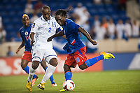 Haiti forward Leonel Saint Preux (18) is marked by Honduras defender Osman Chavez (2). Honduras defeated Haiti 2-0 during a CONCACAF Gold Cup group B match at Red Bull Arena in Harrison, NJ, on July 8, 2013.