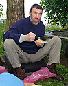 *** WARNING CONTENT MAY NOT BE SUITABLE FOR ALL ***.Naked rambler Stephen Gough enjoys his delivered takeaway dinner from a local Indian takeaway in the woods near Kinross.