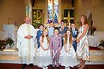 Pupils from Scoil Mhichíl Naofa, Ballinskelligs who made their First Holy Communion on Saturday in St Michael the Archangel Church were front l-r; Kayla Breathnacht, Sean Ó Súilleabháin, Evie Nic Cárthaigh, back l-r; Fr Patsy Lynch, Aidan Ó Drisceoil, Dylan Ó Drisceoil, Séamus Ó Siochrú, Shane Ó Conchúir agus Múinteoir Síle.