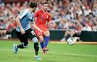 St. Louis, MO - SEPTEMBER 10: Daniel Lovitz #16 of the United States passes off the ball during their game versus Uruguay at Busch Stadium, on September 10, 2019 in St. Louis, MO.