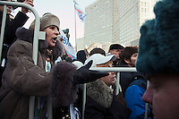 Moscow, Russia, 10/03/2012..A woman argues with police as up to  20,000 people protest in central Moscow against Vladimir Putin's victory in the Russian presidential election.