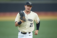 Wake Forest Demon Deacons right fielder Michael Ludowig (22) jogs off the field between innings of the game against the Miami Hurricanes at David F. Couch Ballpark on May 11, 2019 in  Winston-Salem, North Carolina. The Hurricanes defeated the Demon Deacons 8-4. (Brian Westerholt/Four Seam Images)