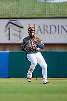Arkansas Travelers right fielder Keury De La Cruz (34) fields a ball during a game against the Frisco RoughRiders on May 28, 2017 at Dickey-Stephens Park in Little Rock, Arkansas.  Arkansas defeated Frisco 17-3.  (Mike Janes/Four Seam Images)
