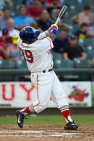 Wearing an Austin Senators throwback uniform, Round Rock Express designated hitter Manny Ramirez (39) follows through on a third inning home run during the Pacific Coast League baseball game against the Oklahoma City RedHawks on July 9, 2013 at the Dell Diamond in Round Rock, Texas. Round Rock defeated Oklahoma City 11-8. (Andrew Woolley/Four Seam Images)