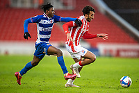 6th February 2021; Bet365 Stadium, Stoke, Staffordshire, England; English Football League Championship Football, Stoke City versus Reading; Omar Richards of Reading chases down Jacob Brown of Stoke City