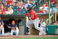Pawtucket Red Sox left fielder Aneury Tavarez (20) follows through on a swing during a game against the Rochester Red Wings on July 4, 2018 at Frontier Field in Rochester, New York.  Pawtucket defeated Rochester 6-5.  (Mike Janes/Four Seam Images)