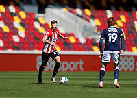 17th April 2021; Brentford Community Stadium, London, England; English Football League Championship Football, Brentford FC versus Millwall; Vitaly Janelt of Brentford is covered by Ryan Woods of Millwall