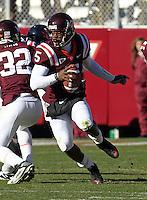 Nov 27, 2010; Charlottesville, VA, USA; Virginia Tech Hokies quarterback Tyrod Taylor (5) runs the ball during the game against the Virginia Cavaliers at Lane Stadium. Virginia Tech won 37-7. Mandatory Credit: Andrew Shurtleff-