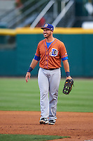 Durham Bulls first baseman J.P. Arencibia (16) jokes with teammates in the dugout during a game against the Buffalo Bisons on June 13, 2016 at Coca-Cola Field in Buffalo, New York.  Durham defeated Buffalo 5-0.  (Mike Janes/Four Seam Images)