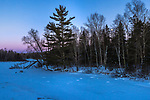 The moon rising over the frozen Chippewa River in the Chequamegon National Forest.