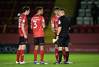 Lincoln City players, from left, Conor McGrandles, Max Melbourne and Sean Roughan speak to the assistant referee, who failed to award their side a second half penalty, following the game<br /> <br /> Photographer Chris Vaughan/CameraSport<br /> <br /> EFL Papa John's Trophy - Northern Section - Group E - Lincoln City v Manchester City U21 - Tuesday 17th November 2020 - LNER Stadium - Lincoln<br />  <br /> World Copyright © 2020 CameraSport. All rights reserved. 43 Linden Ave. Countesthorpe. Leicester. England. LE8 5PG - Tel: +44 (0) 116 277 4147 - admin@camerasport.com - www.camerasport.com
