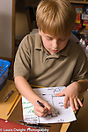 Elementary school Grade 2 boy making a map of his apartment