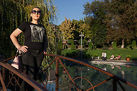 """Armenia. Yerevan. Swan Lake in the town center. Lilit Martirosyan is a transgender woman and a civil rights activist fighting for the rights of trans people in Armenia. She is the founder and the president of the NGO called """"Right Side"""", founded in 2016 to defend and fight for the rights of the trans community in Armenia. Lilit Martirosyan became on April 5th 2019 the first member of her country's lesbian, gay, bisexual, transgender and intersex (LGBTI) community to deliver a speech on the parliamentary podium, speaking out against discrimination at a session of its committee on human rights. A trans woman (sometimes trans-woman or transwoman) is a woman who was assigned male at birth. Trans women may experience gender dysphoria and may transition; this process commonly includes hormone replacement therapy and sometimes sex reassignment surgery, which can bring immense relief and even resolve gender dysphoria entirely. Yerevan, sometimes spelled Erevan, is the capital and largest city of Armenia. 10.10.2019 © 2019 Didier Ruef"""