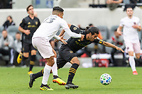 LOS ANGELES, CA - MARCH 01: Victor Ulloa #13 of Inter Miami CF takes down Carlos Vela #10 of LAFC during a game between Inter Miami CF and Los Angeles FC at Banc of California Stadium on March 01, 2020 in Los Angeles, California.