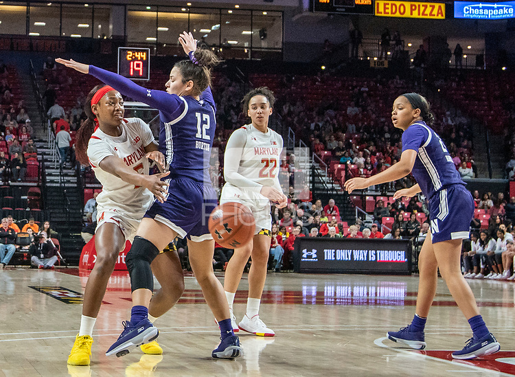 COLLEGE PARK, MD - JANUARY 26: Kaila Charles #5 of Maryland passes behind Veronica Burton #12 of Northwestern during a game between Northwestern and Maryland at Xfinity Center on January 26, 2020 in College Park, Maryland.