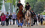 LOUISVILLE, KY -MAY 10: Kentucky Derby winner Justify, with exercise rider Humberto Gomez, was led to the track by assistant trainer Jimmy Barnes on Sunny for a gallop at Churchill Downs, Louisville, Kentucky. it was his first visit to the track since his Kentucky Derby win five days earlier. (Photo by Mary M. Meek/Eclipse Sportswire/Getty Images)