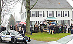 NEWTOWN, CT - 17 December 2012-121712EC02--    The first burials for Friday's shooting victims began Monday.  Mourners wait outside of Honan Funeral Home on Main Street in Newtown to pay their respects to the family of 6-year-old Jack Pinto.  The first-grader was then laid to rest at Newtown Village Cemetery.  Erin Covey Republican-American.