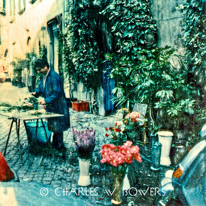 The village florist prepares to bring beauty to your day. Perhaps your friend or lover will bring you some of his bounty today.<br /> <br /> -Limited Edition of 50 Prints