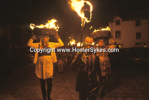 Allendale Tar Barrel Parade. Allendale Northumberland. Uk. New Years Eve. Fire Festival. Guisers walk around the small town with burning half tar barrels on thier heads and at midnight place them on a huge bonfire in the centre of town.