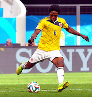 BRASILIA - BRASIL -19-06-2014. Carlos Sanchez jugador de Colombia (COL) en acción durante partido del Grupo C contra Costa de Marfil (CIV) por la Copa Mundial de la FIFA Brasil 2014 jugado en el estadio Mané Garricha de Brasilia./ Carlos Sanchez player of Colombia (COL) in action during the macth of the Group C against Costa de Marfil (CIV) for the 2014 FIFA World Cup Brazil played at Mane Garricha stadium in Brasilia. Photo: VizzorImage / Alfredo Gutiérrez / Contribuidor