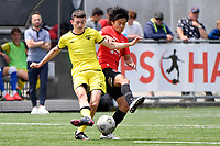 Luis Toomey of the Wellington Phoenix competes for the ball with Yuya Taguchi of Canterbury United during the ISPS Handa Men's Premiership - Wellington Phoenix Reserves v Canterbury United at Fraser Park, Wellington on Saturday 9 January 2021.<br /> Copyright photo: Masanori Udagawa /  www.photosport.nz