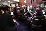 Nevada Sen. Patricia Spearman, D-North Las Vegas, talks with her assistant Pastor Sharlene Myles, left, and her sister Millie Spearman-Royster during the opening day of the 77th Legislative Session in Carson City, Nev. on Monday, Feb. 4, 2013. <br />