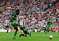 Bafetibis Gomis of Swansea City (left) scores their first goalduring the Barclays Premier League match between Sunderland and Swansea City played at Stadium of Light, Sunderland