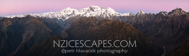 Alpen Glow, twilight, dusk on highest peaks of Southern Alps Mount Tasman, Aoraki Mount Cook and La Perouse. Cook River bottom right, Balfour Glacier in centre, Westland Tai Poutini National Park, UNESCO World Heritage Area, West Coast, New Zealand, NZ