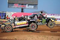 Apr 16, 2011; Surprise, AZ USA; LOORRS driver Jeremy McGrath (2) jumps alongside Greg Adler (10) during round 3 at Speedworld Off Road Park. Mandatory Credit: Mark J. Rebilas-