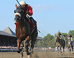 Wicked Strong (no. 7), ridden by Rajiv Maragh and trained by James Jerkens, wins the the 51st running of the grade 2 Jim Dandy Stakes for three year olds on July 26, 2014 at Saratoga Race Course in Saratoga Springs, New York.  (Bob Mayberger/Eclipse Sportswire)