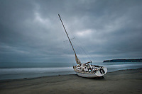 An abandoned Sailboat washed ashore in Coronado, Calif.