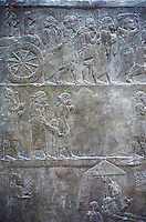 Stone relief sculptured panel of prisoners from the campaign of Elam. From the palace of Ashurnasirpal II  room VI/T1, Niniveh, circa 645 BC. inv 19908  Louvre Museum , Paris