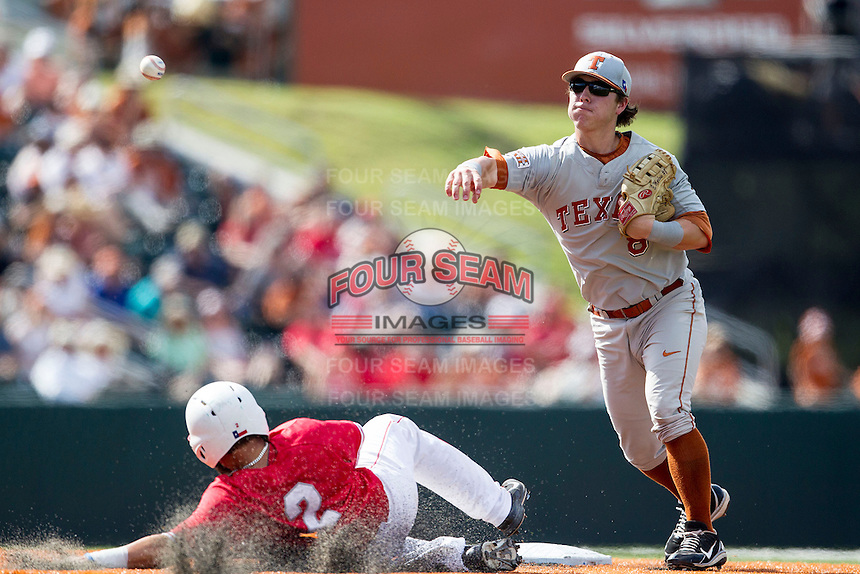 Texas Longhorns second baseman Brooks Marlow (8) turns a double play as Houston Cougars base runner Michael Pyeatt (2) slides into second base during the NCAA baseball game on June 6, 2014 at UFCU Disch–Falk Field in Austin, Texas. The Longhorns defeated the Cougars 4-2 in Game 1 of the NCAA Super Regional. (Andrew Woolley/Four Seam Images)