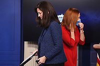 White House deputy national security adviser Anne Neuberger, left, walks from the podium next to White House Press Secretary Jen Psaki, listens during a press briefing on Wednesday, February 17, 2021, in Washington, DC.<br /> Credit: Oliver Contreras / Pool via CNP /MediaPunch