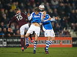 Hearts v St Johnstone.....05.03.13      SPL.Dave Mackay and Murray Davidson battle with Arvydas Novikovas.Picture by Graeme Hart..Copyright Perthshire Picture Agency.Tel: 01738 623350  Mobile: 07990 594431