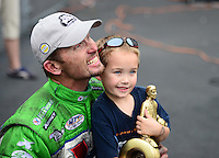 Sept. 30, 2012; Madison, IL, USA: NHRA funny car champion Jack Beckman celebrates with son Jason Beckman after winning the Midwest Nationals at Gateway Motorsports Park. Mandatory Credit: Mark J. Rebilas-