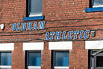 Oldham v Portsmouth League 1. The Oldham athletic sign on the back of he George Hill Main Stand.