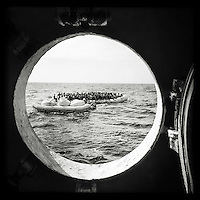 Sea Watch-2.<br /> Die Sea Watch-2 bei ihrer 13. SAR-Mission vor der libyschen Kueste.<br /> Im Bild: Gefluechtete werden von der Sea Watch-Crew mit Schwimmwesten versorgt.<br /> 21.10.2016, Mediterranean Sea<br /> Copyright: Christian-Ditsch.de<br /> [Inhaltsveraendernde Manipulation des Fotos nur nach ausdruecklicher Genehmigung des Fotografen. Vereinbarungen ueber Abtretung von Persoenlichkeitsrechten/Model Release der abgebildeten Person/Personen liegen nicht vor. NO MODEL RELEASE! Nur fuer Redaktionelle Zwecke. Don't publish without copyright Christian-Ditsch.de, Veroeffentlichung nur mit Fotografennennung, sowie gegen Honorar, MwSt. und Beleg. Konto: I N G - D i B a, IBAN DE58500105175400192269, BIC INGDDEFFXXX, Kontakt: post@christian-ditsch.de<br /> Bei der Bearbeitung der Dateiinformationen darf die Urheberkennzeichnung in den EXIF- und  IPTC-Daten nicht entfernt werden, diese sind in digitalen Medien nach §95c UrhG rechtlich geschuetzt. Der Urhebervermerk wird gemaess §13 UrhG verlangt.]