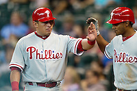 Philadelphia Phillies catcher Carlos Ruiz #51 is greeted by Michael Martinez after he scored in the eighth inning of the Major League baseball game against the Houston Astros on September 16th, 2012 at Minute Maid Park in Houston, Texas. The Astros defeated the Phillies 7-6. (Andrew Woolley/Four Seam Images).