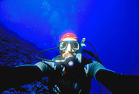 Underwater photographer - Self portrait of Jack Grove. Jack Grove. Puka Puka Atoll Polynesia South Pacific Blue water at 60 feet of depth.